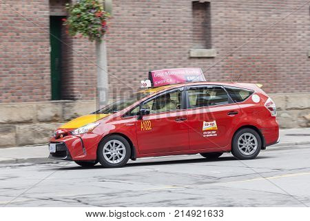 Toronto Canada - Oct 14 2017: Red Toyota Prius V hybrid MPV used as a taxi in the city of Toronto
