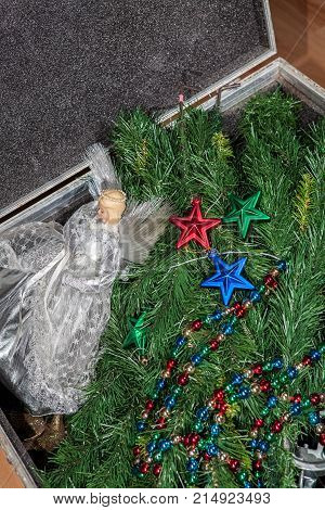 Preparing for Christmas. Artificial tree stored before and after xmas. Fairy and decorations stored in an attic storage case.