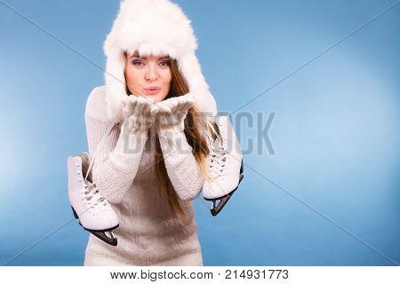 Woman Wearing Fur Cap Holding Ice Skates
