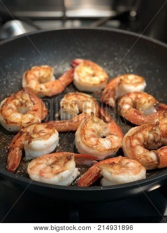 beautiful prawns being made in the frying pan