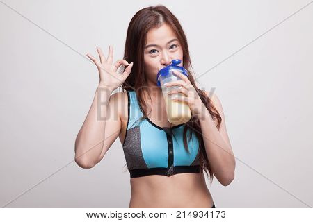 Beautiful Asian Healthy Girl Show Ok Drink Whey Protein.