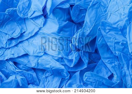 Pile of blue nitrile healthcare gloves background