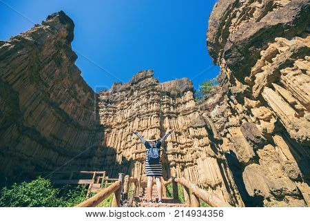Young Asian Woman Traveler Travelling To Wonderful Soil Cliff Pha Cho At Mae Wang National Park, Doi