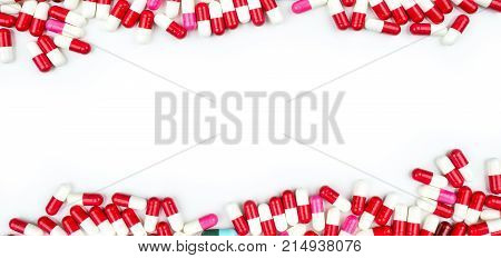 Colorful of antibiotic capsules pills isolated on white background with copy space for text. Drug resistance concept. Antibiotics drug use with reasonable and global healthcare concept.