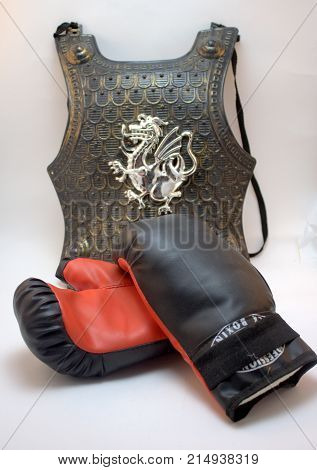 Breast protective helmet of the knight family coat of arms and combat sports Boxing gloves.  This is earned armor. They participated in many sports among boys. Knew victory and defeat.