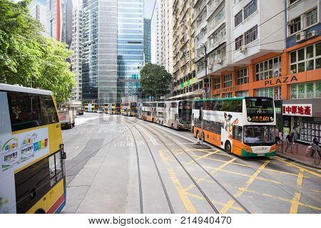 Causeway BayHong Kong S.A.R.-July 132017:Colorful Advertisement Double decker public bus queue in line on street in downtown. Hong Kong is one of the few cities in the world that bus services are not operated or owned by the Government