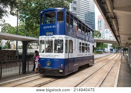 Hong Kong S.A.R. - July 13 2017: Double decker tram or Ding Ding on the street in Causeway Bay Hong Kong. Hong Kong tramways is one of the earliest forms of public transport in the metropolis