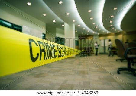 crime scene tape focus on word 'crime' in cenematic dark tone with copy space