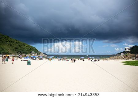 Hong Kong China - july 14 2017. Rain cloud and storm over Big wave bay beach eastern coast of Hong Kong Island.Big Wave Bay or Tai Long Wan is located on south of Cape Collinson and north of Shek O.