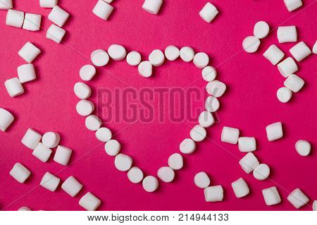 Marshmallow, white marshmallow. Sweet heart. Heart of sweets. Heart of marshmallow