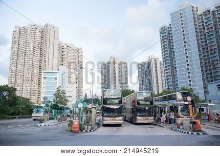 Tsing Yi Hong Kong- September 222017: Double decker bus park at Tsing Yi Bus station with resident building background.Tsing Yi Island is an island in the urban area of Hong Kong with an area of 10.69 sq.km