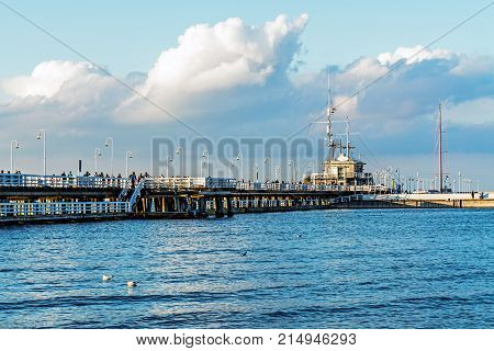 SOPOT, POLAND - JULY 8, 2017: Scenes from the ancient wooden pier, built in 1827 at 511 m remaining the longest wooden pier in Europe and the main attraction of the resort.