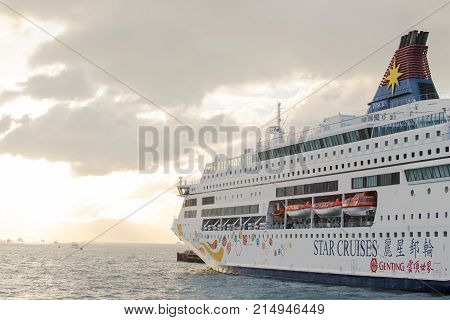 Hong Kong S.A.R.China - September 24 2017: Star Pisces of Star cruises ocean liners at ocean terminalTsim sha tsui Kowloon in sunset.Star Cruises is the third largest cruise line in the world