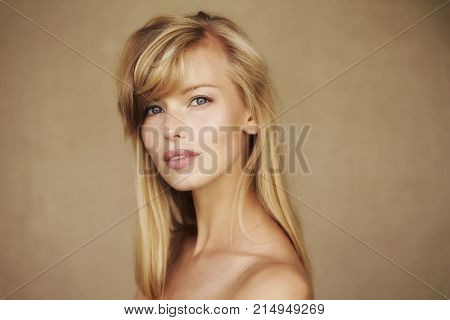 Stunning young blond woman looking at camera