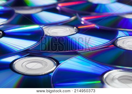 Pile of CD Compact Discs and DVDs with nice reflections