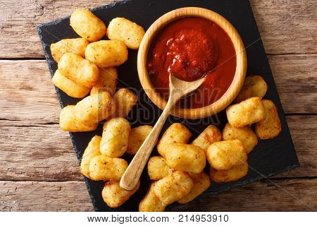 Homemade Tater Tots With Tomato Sauce Close Up. Horizontal Top View
