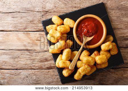 Deep-fried Potato Tater Tots And Ketchup Close-up. Horizontal Top View