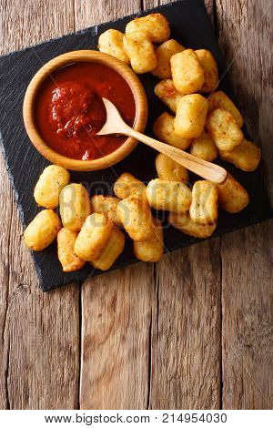 Close Up Of Rustic Golden Potato Tater Tots And Ketchup. Vertical Top View