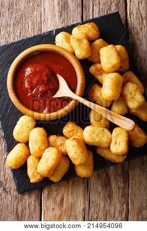Deep-fried Potato Tater Tots And Ketchup Close-up. Vertical Top View