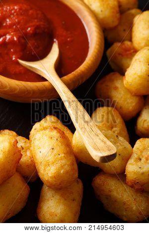 American Food: Tater Tots And Ketchup Close-up. Vertical