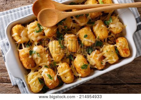 Casserole Of Tater Tots With Cheese And Herbs Close Up In A Baking Dish. Horizontal Top View