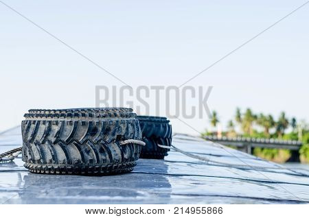 Old Car Tires On The Boat In Thai River