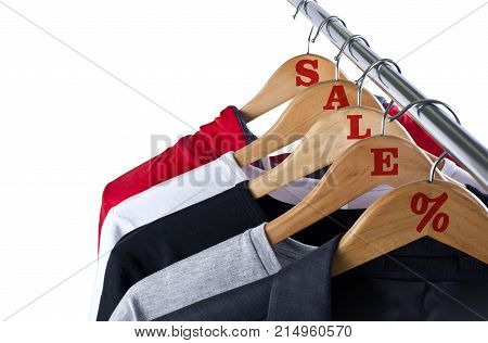 Black Friday shopping sale concept. Sale in a clothing store - discount sign at a clothes rack