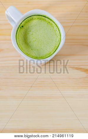 Milk matcha green tea on wooden table