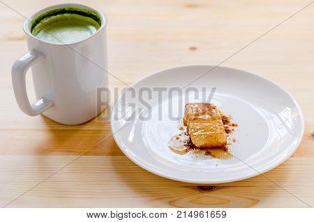 Dessert And Milk Green Tea On Wooden Table