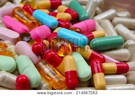 Medical or vitamin pills. Colorful medicine pills as texture. Pill pattern background. Colorful pill texture.
