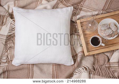 White linen pillow, cushion Mockup on plaid. Inrerior photo.