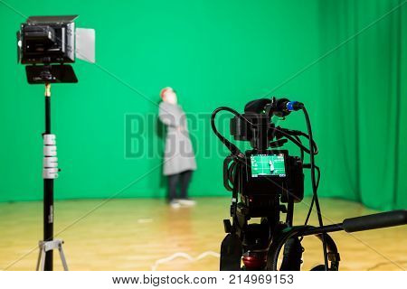Saratov, Russia, November 21, 2017: The actor starred in the interior on a green background. The chroma key. Filming equipment.