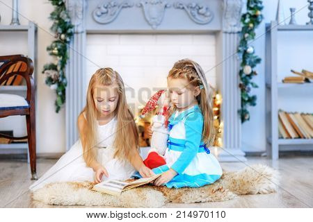 Sisters Read A Story At Night. Concept New Year, Merry Christmas