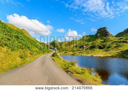 Tourist Hiking The Mystic Fairy Glen, A Romantic Green Valley In The Isle Of Skye.