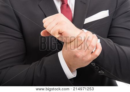 Close-up Of Business Man Standing Holding Wrist Like Hurting