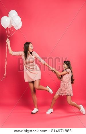 Daughter Holding Mother With Helium Balloons