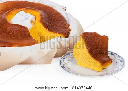 Pao de Lo, the Portuguese sponge cake shown in its most traditional form, with the typical paper sheets used on the baking, isolated on white background