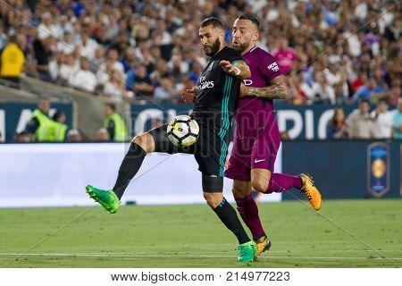 LOS ANGELES, CA - JULY 26: Karim Benzema & Nicolas Otamendi during the 2017 International Champions Cup game between Manchester City & Real Madrid on July 26 2017 at the Los Angeles Memorial Coliseum.