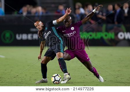 LOS ANGELES, CA - JULY 26: Lucas Vazquez & Eliaquim Mangala during the 2017 International Champions Cup game between Manchester City & Real Madrid on July 26 2017 at the Los Angeles Memorial Coliseum.