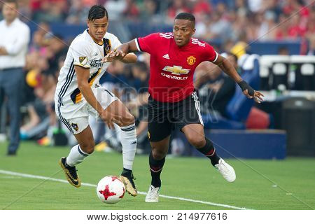 CARSON, CA - JULY 15: Antonio Valencia (R) & Ariel Lassiter (L) during Manchester United's summer tour friendly against the L.A. Galaxy on July 15th 2017 at the StubHub Center.