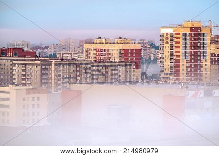 View of the buildings in the city of Izhevsk in a fog