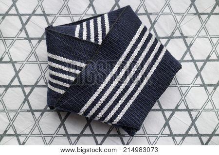 Traditional folded stiff obi belt for mens yukata close up