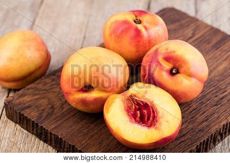 Nectarine fruit on a wooden