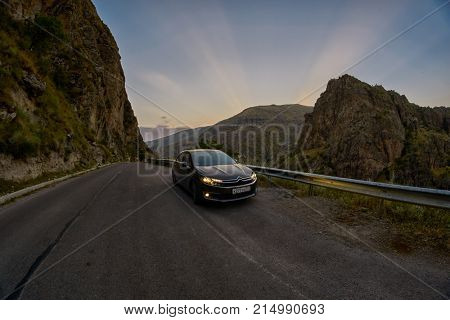 VARDZIA, GEORGIA - 06 AUGUST 2017: Driving curvy scenic mountain route at sunset