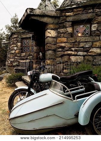 Osaka, Japan - FEB 12, 2017 : Hagrid's motorbike and background home Hagrid at Universal Studios Japan.The Harry Potter is famous themed attractions in the Universal Studios Japan Theme Park.