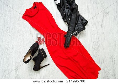 Red Dress With, Black Shoes And Leather Jacket. Fashionable Concept.