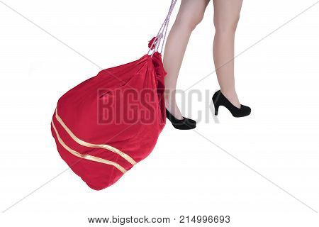Christmas concept : Woman dragging Santa big red heavy bag isolated on white background