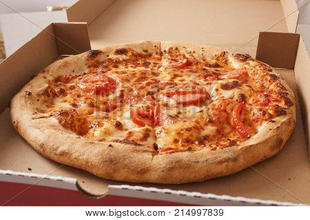 Pizza texture pattern background. Margharita vegetarian pizza close up. Pizza delivery with pizza box banner ad or cover background for your project. Pizza cover.