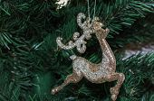 Christmas decoration a golden  reindeer adorns poster