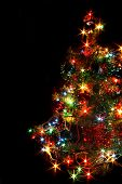 xmas tree with many colored lights on the black backgorund poster